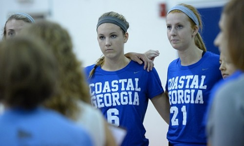 Maddie Bounds (No. 6) listens to instructions during a timeout.