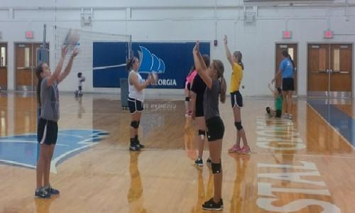 Volleyball team holds summer camps college of coastal georgia campers go through a drill as a group sciox Gallery